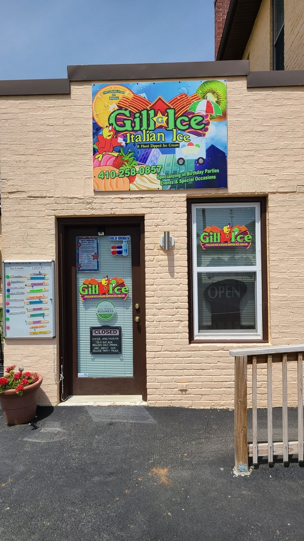 """A brick storefront advertises """"Gill ice"""" and ice cream"""
