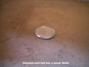 Image of a sandy shower mud deck