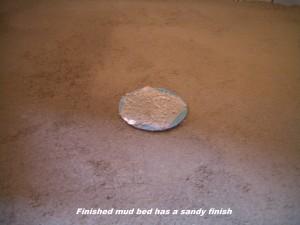 Image of a sandy shower mud deck