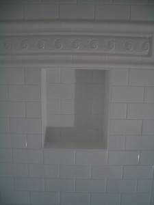 Niche in subway tile shower with listello above