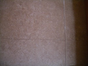 Cracked floor tile due to improper substrate preparation