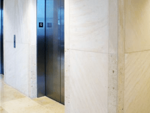 FSI Elevator Custom Stone for Elevator seating area Charles Schwab project