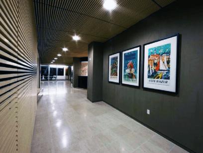 Dark gray colors, neutral hallways, and tile flooring design