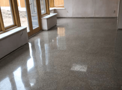 Polished screed floor reflecting daylight