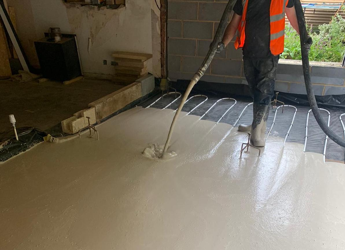 Extra strength screed being poured onto new build floor