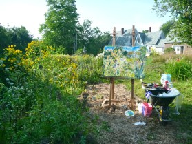 Painting in the vegetable patch.