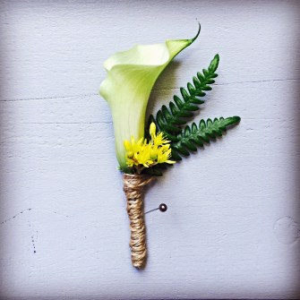 calla lily with sedum & fern boutonniere