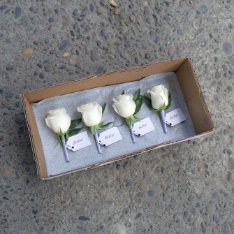 four white rose boutonnieres