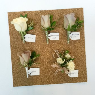 wedding party flowers on corkboard