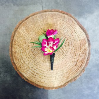 freesia and poppy pod boutonniere