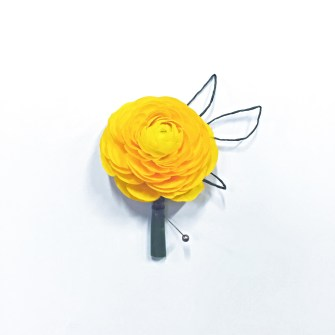 yellow ranunculus with abstract leaves boutonniere