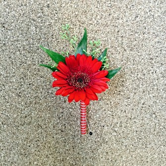 red gerbera daisy boutonniere
