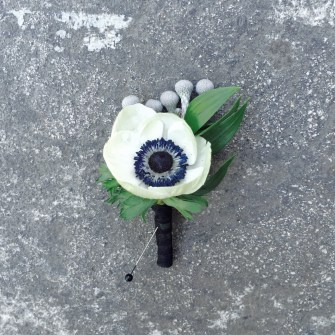 white anemone with brunia berry boutonniere