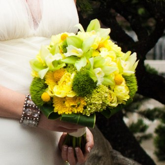 Yellow and green bridal bouquet with great textures like orchids, billy balls and green ball trix