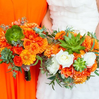 Orange, white & green bridal & bridesmaids bouquet with dahlias, succulents, and roses