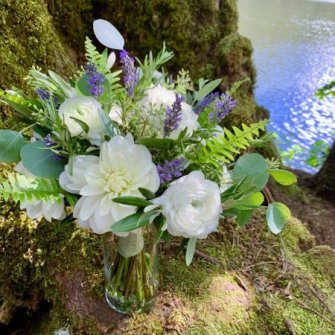 Summer bouquet with white dahlias, lavender and greenery