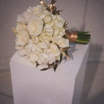 all white with gold accents bridal bouquet