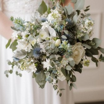 Dusty blue, gray and white garden style bouquet.