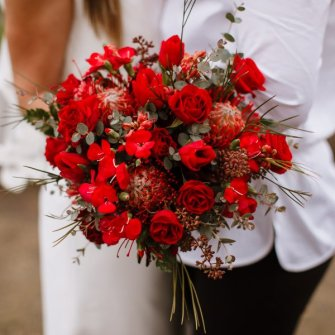 Red flowers for an elopement at Cathedral Park