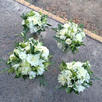 White & green bouquets on the loading dock