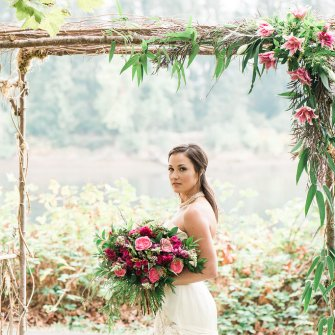 Birch arch with simple corner flowers & bride