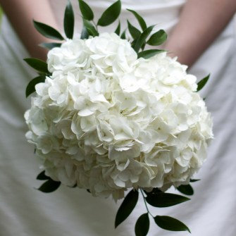 simple white hydrangea bouquet with a touch of Italian ruscus