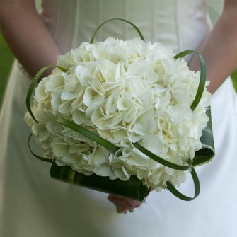 elegant white hydrangea bouquet with simple lily grass