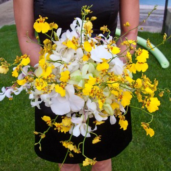 yellow and white orchids bridesmaid's bouquet