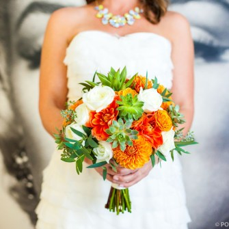 Orange, white & green bridal bouquet with dahlias, succulents, and roses