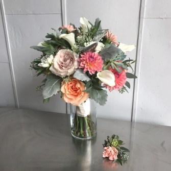Dusty miller, white calla lilies, coral dahlias, & garden roses