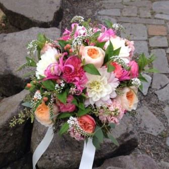 Coral, peach, and white bridal bouquet with Juliet roses
