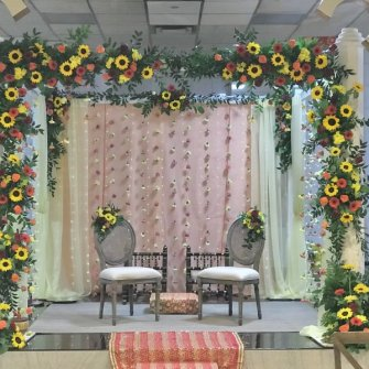 naturally flowing flowers on mandap with hanging garlands