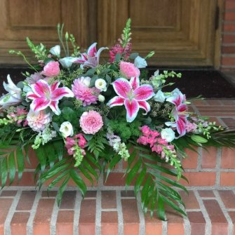 Half casket spray with stargazer lilies and seasonal flowers
