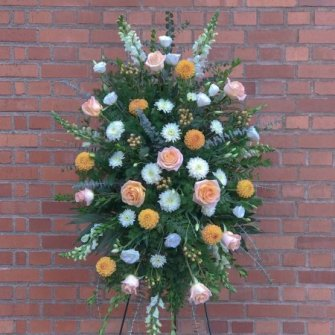 Peaches, oranges & cream standing spray with seasonal flowers
