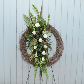 Grapevine wreath with rustic central accent