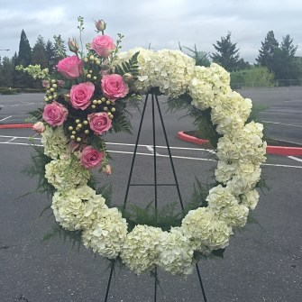 White wreath with pink roses accent