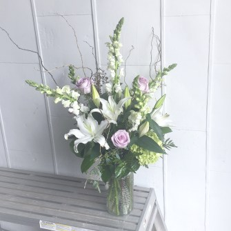 Sympathy arrangement in vase