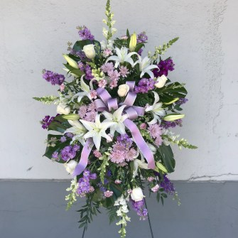 Lavender & white lilies standing spray