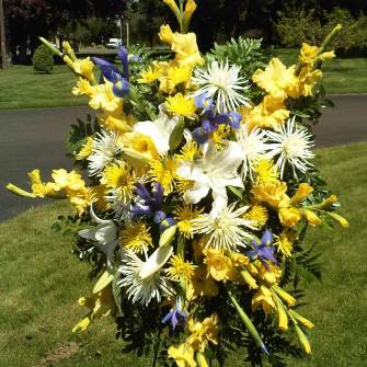 Premium Standing Spray of white lilies, yellow flowers and blue irises