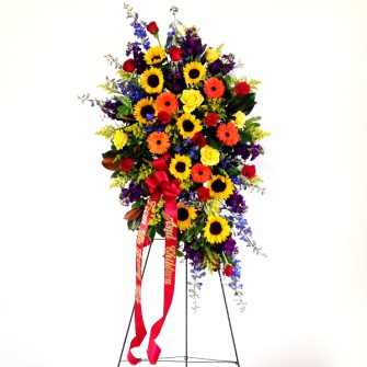 Bold autumn standing spray with sunflowers