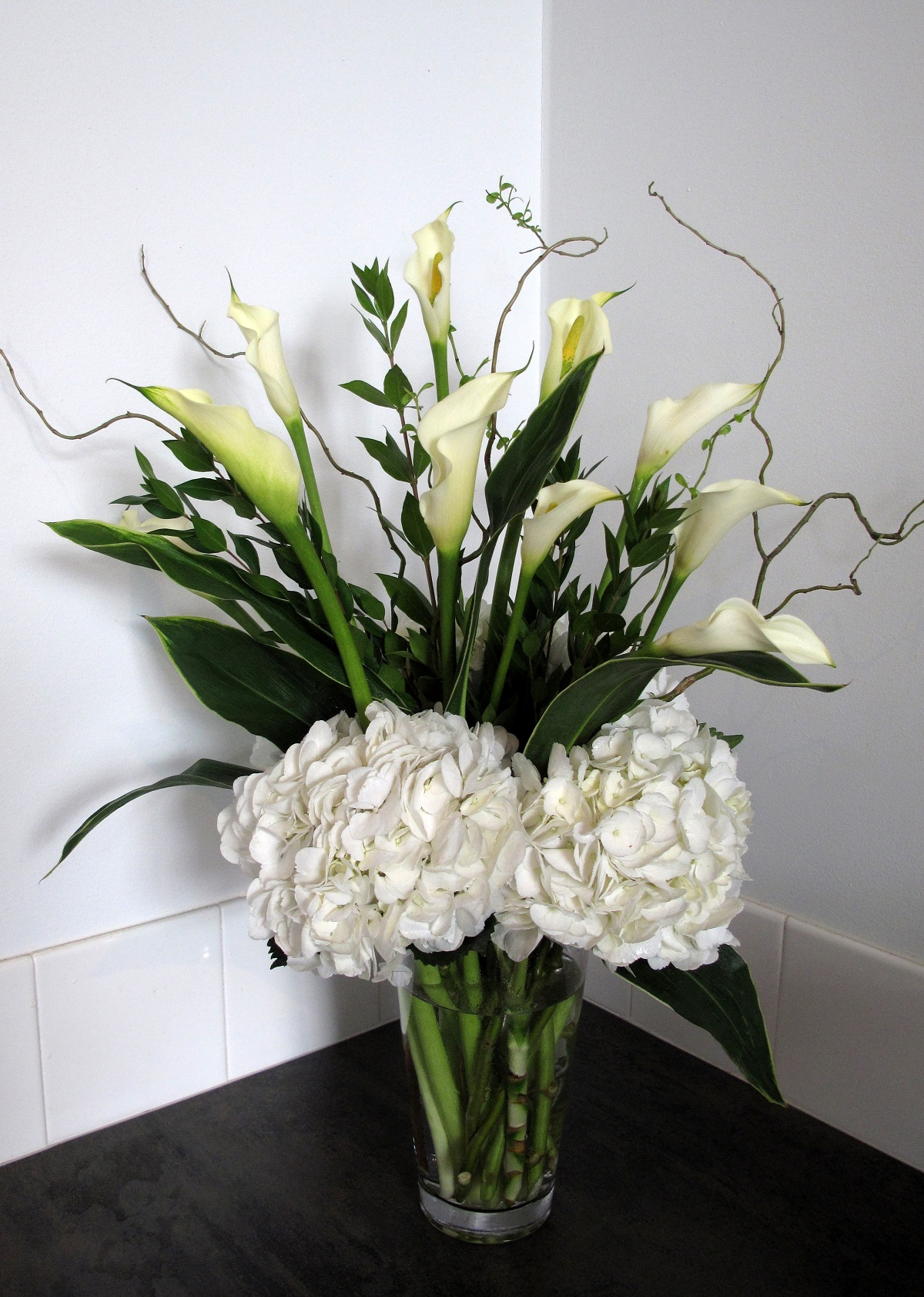 Flower arrangements gallery floral sunshine arrangement of white calla lilies and white hydrangeas stylized with curly willow izmirmasajfo