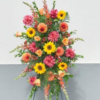 Seasonal colorful standing spray with sunflowers, dahlias and snapdragons