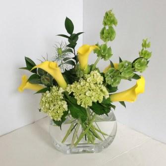 yellow callas, mini green hydrangeas with bells of Ireland