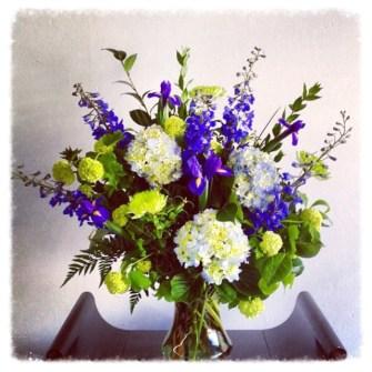 large purple, blue and green vase arrangement