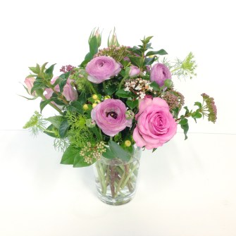 small rustic arrangement of pink flowers