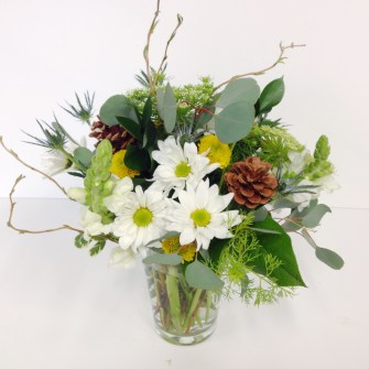small woodsy arrangement of neutral flowers