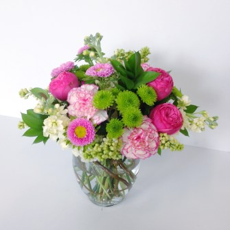 medium springy colorful arrangement of flowers, including garden roses