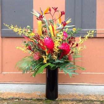 Large tropical arrangement in black vase