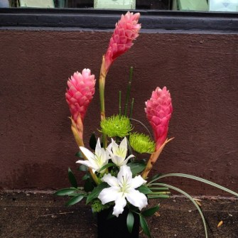 Pink ginger, white lilies and green spider mums
