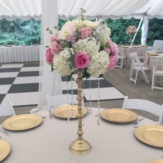elevated centerpieces on gold stands at Abernethy Center